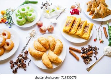 Malaysian traditional foods or kuih. Cream puff, samosa and doughnut