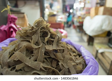 Malaysian traditional raw Fish Cracker known as KEROPOK KEPING in a market for sale.