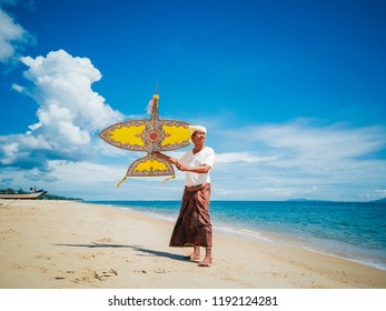 Malaysian traditional Wau or moon kite on the beach