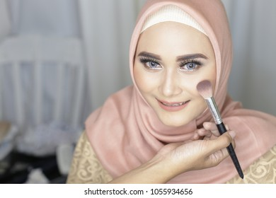 malaysian woman with jilbab and make up beauty. young malaysian muslim woman make up studio and looking at camera smiling. yogyakarta indonesia. march 26, 2018.