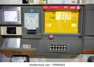 Malaysia-Nov 20, 2017: A car fueling at Petronas petrol pump. From 2014, Malaysia fuel prices will be floated to International price. Fuel price will be revealed at every wednesday of the week.