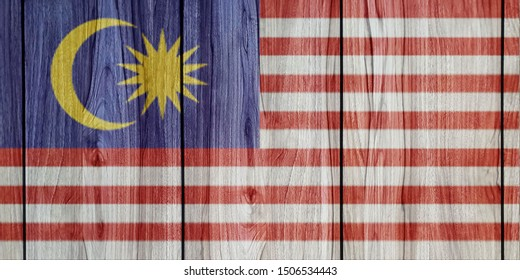 Malaysia's flag on wooden table