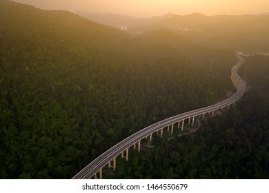 Malaysia's tallest highway, Rawang bypass. Long highway toward a sunset scenery with beautiful green nature and orange sky in dusk.