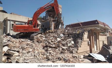 Malaz, Riyadh / Saudi Arabia - January 10 2019: Hydraulic Demolition Machine breaking an old building