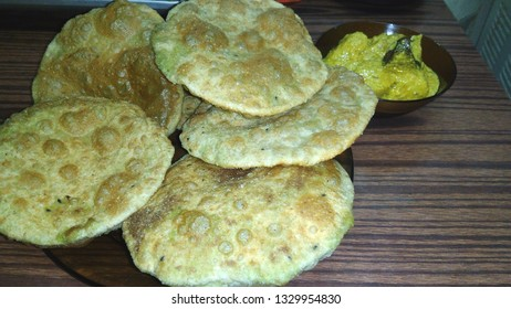 Malaz, Riyadh / Saudi Arabia - March 4 2019: An Indian cuisine, Green peas kachori  ( Koraishutir  Kachori ).