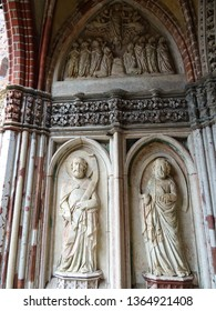 Malbork castle / Poland - 03 26 2019 : relief of saints on entrance to Saint Anne's chapel in High Castle section of Malbork castle (Marienburg), Malbork town, Pomerania, Poland, Eastern Europe