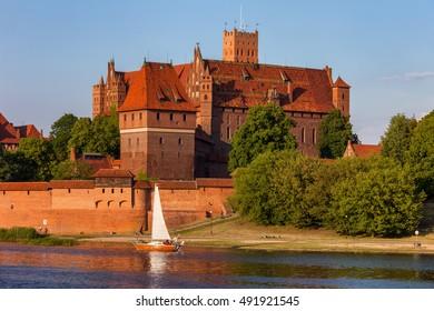 Malbork Castle in Poland, high castle, view from Nogat River, medieval landmark