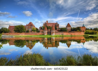 Malbork Castle Reflecting in the River Nogat, Poland, on a Calm Day