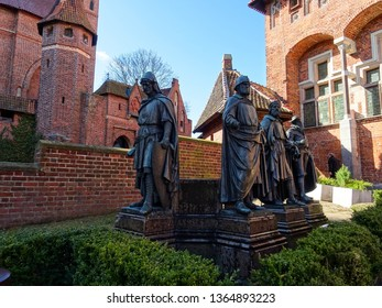 Malbork / Poland - 03 26 2019 : statues of Teutonic Grand Masters, leaders of Order of Teutonic knights which built in 13th century Malbork castle, medieval fortress with brick walls, Eastern Europe