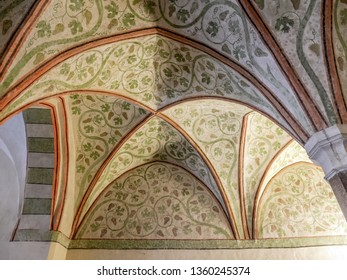 MALBORK, POLAND - 15 AUGUST, 2013: Gothic cloister canopy of Teutonic Malbork castle, Poland. Malbork castle is the largest brick fortress in the world