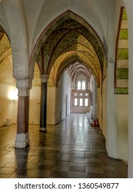 MALBORK, POLAND - 15 AUGUST, 2013: Gothic cloister of Teutonic Malbork castle, Poland. Malbork castle is the largest brick fortress in the world