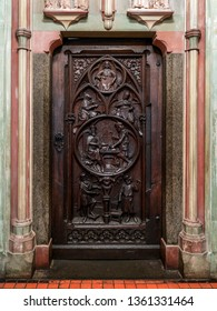 MALBORK, POLAND - 15 AUGUST, 2013: Old wooden doors with relief - Teutonic Malbork castle, Poland. Malbork castle is the largest brick fortress in the world