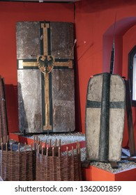 MALBORK, POLAND - 15 AUGUST, 2013: Historical Teutonic shields  exhibited in the museum in the Teutonic Malbork castle, Poland. Malbork castle is the largest brick fortress in the world