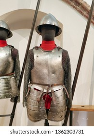MALBORK, POLAND - 15 AUGUST, 2013: 17th century European armour and pike exhibited in the museum in the Teutonic Malbork castle, Poland. Malbork castle is the largest brick fortress in the world