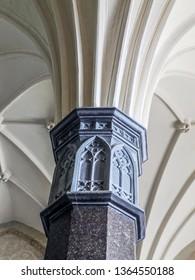 MALBORK, POLAND - 15 AUGUST, 2013: Gothic cloister column, Teutonic Malbork castle, Poland. Malbork castle is the largest brick fortress in the world