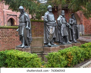 MALBORK. POLAND. 23 OCT 2017 : Monumental sculptures of four Grand Masters of Teutonic Order inside Castle of in Malbork.
