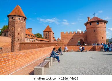 Malbork, Poland - AUGUST 28, 2018: Tourists visit the castle in Malbork. Poland