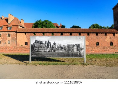 Malbork, Poland - June 03 2018: Old photograph of the ruins of Malbork Castle after WWII against the backdrop of a restored castle
