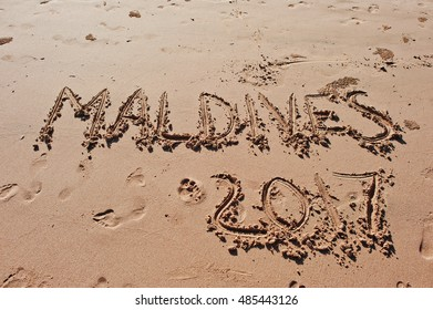 """""""Maldives 2017"""" written in the sand on the beach"""