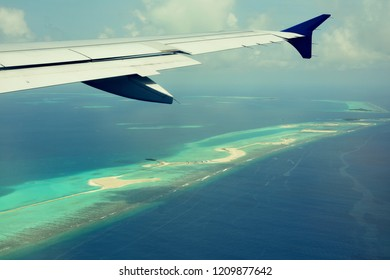 Maldives : August 16,2017 - a stunning view of atoll of Maldives Island seen from aircraft  Air Asia FD 178 ,departed from Maldives.