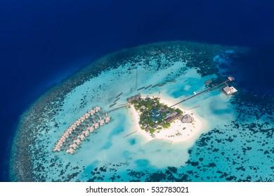 Maldives beach aerial view, Ari atoll. Tropical islands and atolls in Maldives from aerial view.