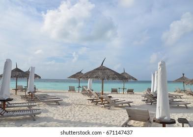 Maldives beach with umbrella