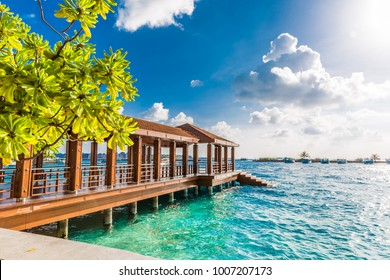 Maldives dock and airport area for tourists in a sunny day.