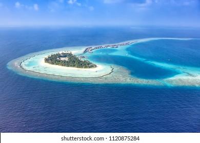 Maldives island vacation sea panorama copyspace Halaveli Resort Ari Atoll aerial photo tourism