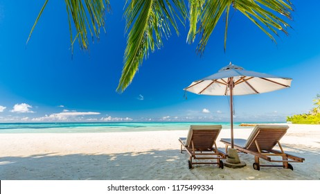 Maldives islands with blue sea water, pretty endless beach, soft white sands, luxury water villa, straight coconut trees, wonderful sunset and sun rise, blue sky. Luxury summer vacation concept