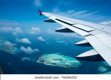 Maldives islands top view from flight with airplane window