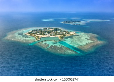 Maldives islands vacation paradise Bodufolhudhoo and Nika Island copyspace copy space sea Ari Atoll aerial photo tourism
