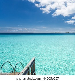 Maldives. Moody blue sky and lagoon.