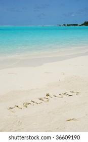 Maldives note written on a white sandy beach