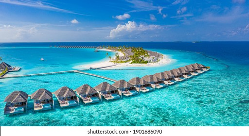 Maldives paradise scenery. Tropical aerial landscape, seascape with long jetty, water villas with amazing sea and lagoon beach, tropical nature. Exotic tourism destination banner, summer vacation - Shutterstock ID 1901686090
