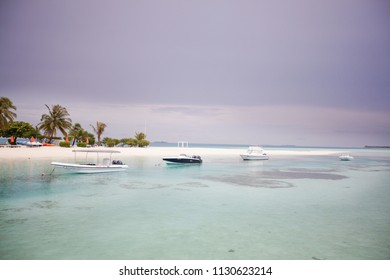MALDIVES SEPTEMBER 2014 - Small boat are floating on the sea water in front of luxury hotel in Maldives during summer holiday season