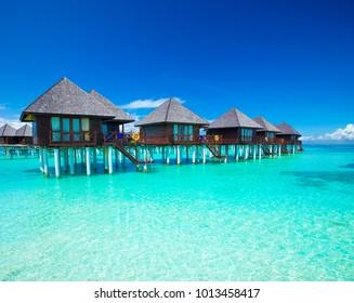 Maldives water bungalow on ocean water landscape