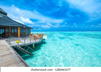 Maldives water bungalow on ocean water landscape