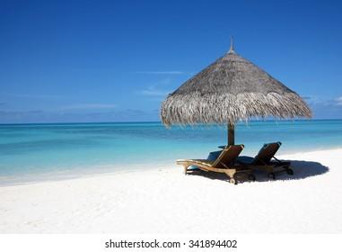 Maldives: white sands, beautiful beaches, umbrellas