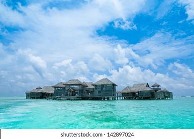 Maldives.Villa on piles on water,Island in ocean
