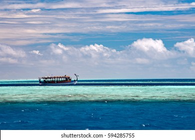 maldivian dhoni boat in blue ocean background