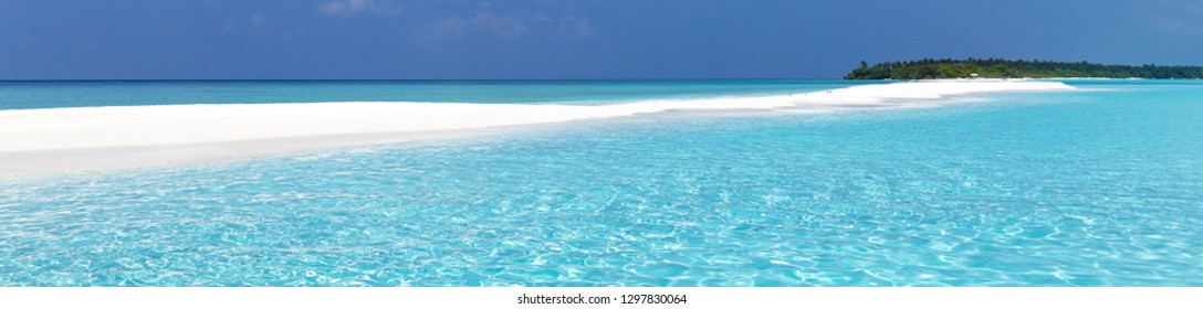 Maldivian sandbank in Indian ocean, white sandy coast with crystal azure color water, long banner