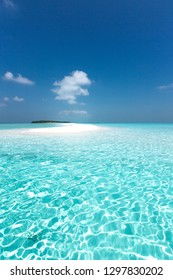 Maldivian sandbank in Indian ocean, white sandy coast with crystal azure color water, perfect getaway for tropical vacations