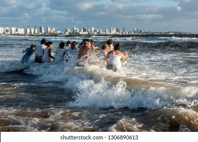 Maldonado, Uruguay - February 2, 2019: Parishioners of the Umbandist church worship Orisha Yemanja (Iemanja) on the Playa Mansa beach in Punta del Este