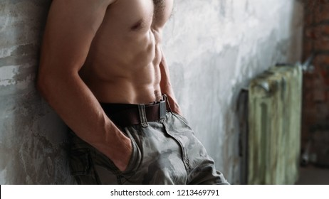 male abs and bare chest. sexy fit body and strong muscles. sport workout and exercises concept.