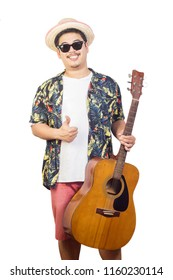 Male and acoustic guitar in holiday summer