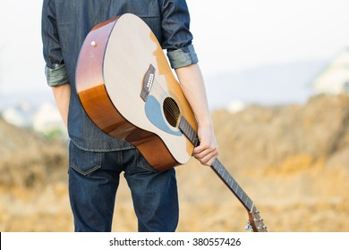 Male with acoustic guitar outdoor