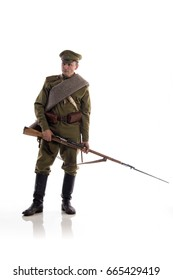 Male actor in the form of an ordinary soldier of the Russian army during the First World War posing against a white background in the studio