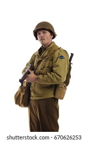 Male actor in military uniform of American ranger of World War II period posing against white background