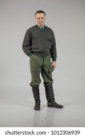 male actor movie in the role in the winter military uniform of an old soldier, the period 1942, the Second World War, posing on a gray background