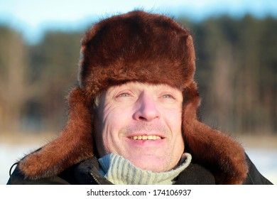 male adult fur hat winter forest